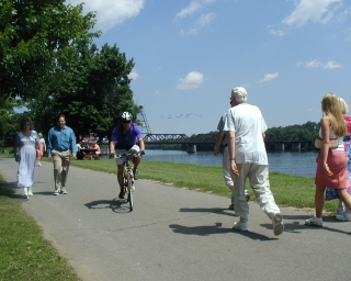 Biker and pedestrians on the Corning Preserve Trail in Albany, New York.